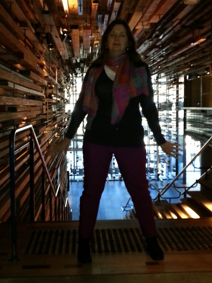 wearing ponti pants standing at the top of the stairs ar the nishi hotel