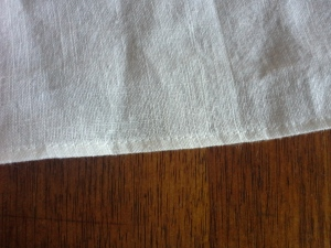 Right side of rolled hem on white linen