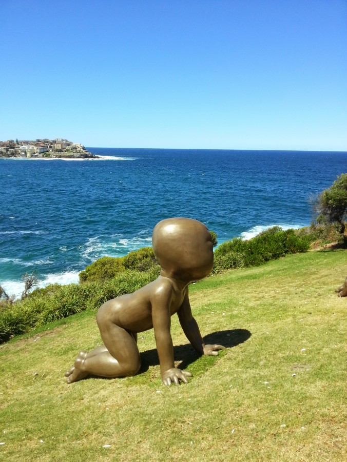 Giant baby sculpture by the sea